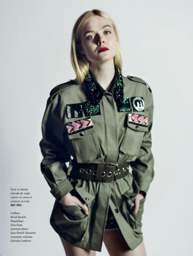 Elle Fanning poses in Miu Miu jacket and shorts