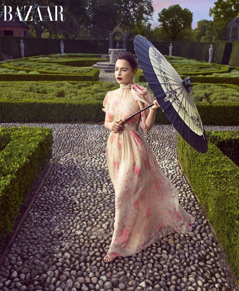 Actress Emilia Clarke poses in Valentino gown, Gianvito Rossi sandals and Gucci umbrella