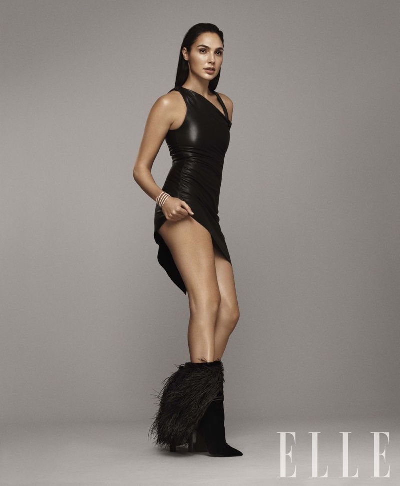 Gal Gadot poses in Saint Laurent leather dress and boots with David Yurman bracelet
