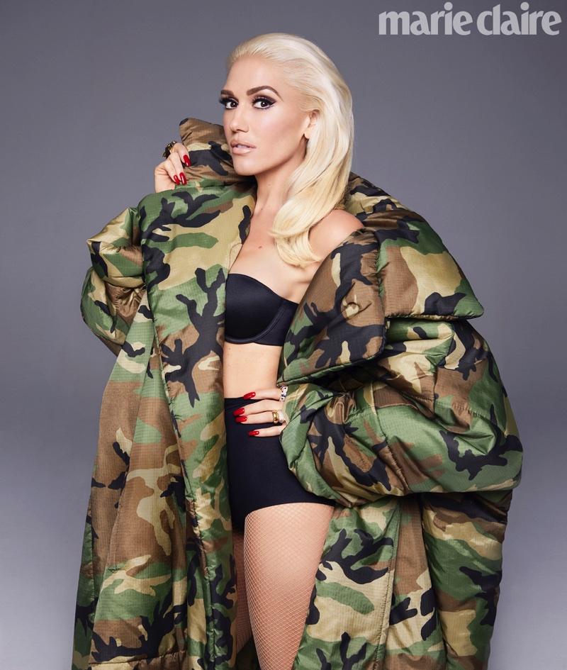 Striking a pose, Gwen Stefani wears Norma Kamali coat, La Perla bra and briefs with Cartier rings