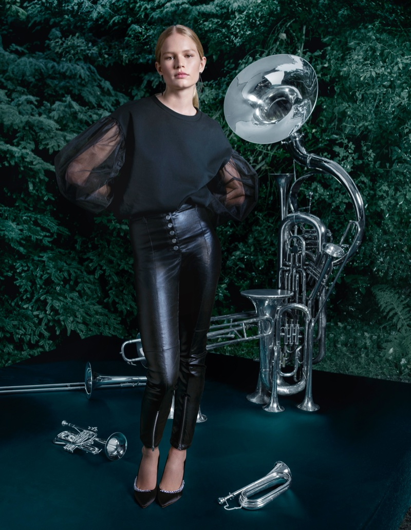 Anna Ewers models H&M Sweatshirt with Tulle Sleeves, Coated Slim-Fit Pants and Satin Pumps with Rhinestones