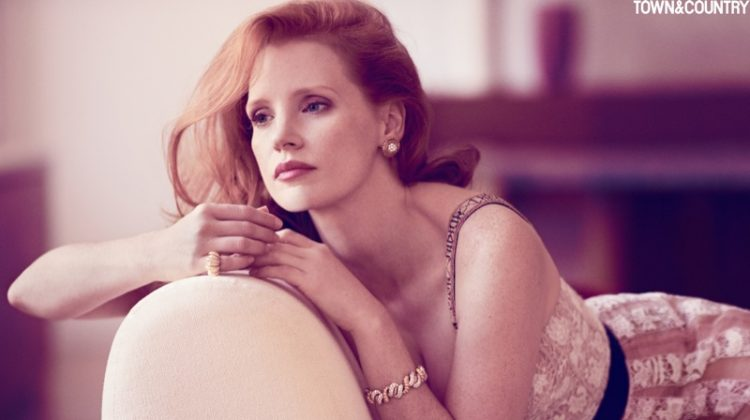 Jessica Chastain poses in Dior dress with vintage Cartier ring and bracelet