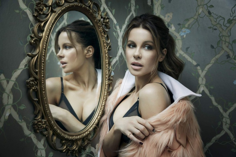 Kate Beckinsale poses in Louis Vuitton coat, Calvin Klein bra and Bulgari ring