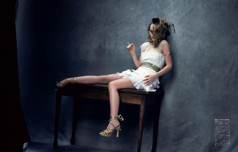 Wearing white, Lily-Rose Depp poses in Chanel dress