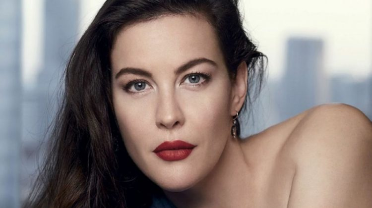 Flaunting some shoulder, Liv Tyler wears Michael Kors Collection toga dress