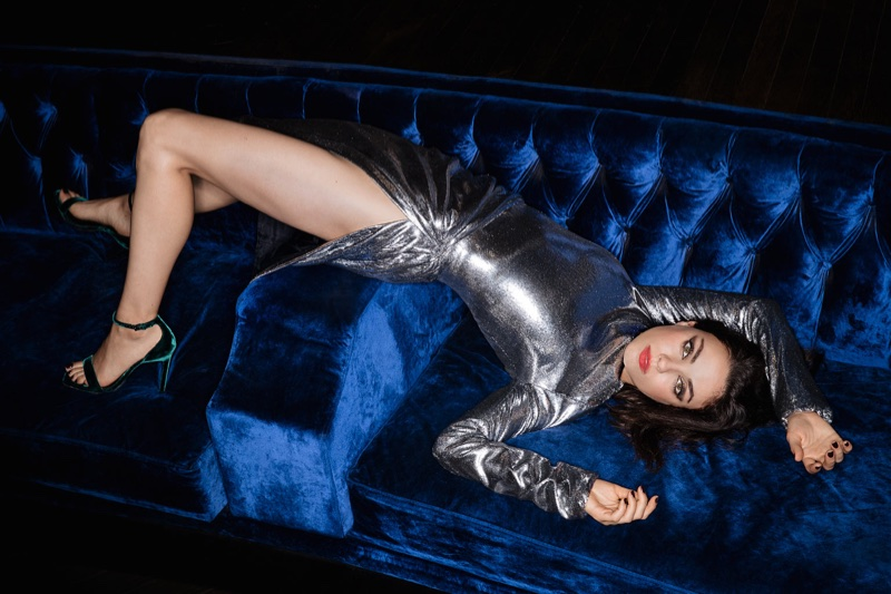 Actress Mila Kunis wears silver Saint Laurent dress and velvet heels