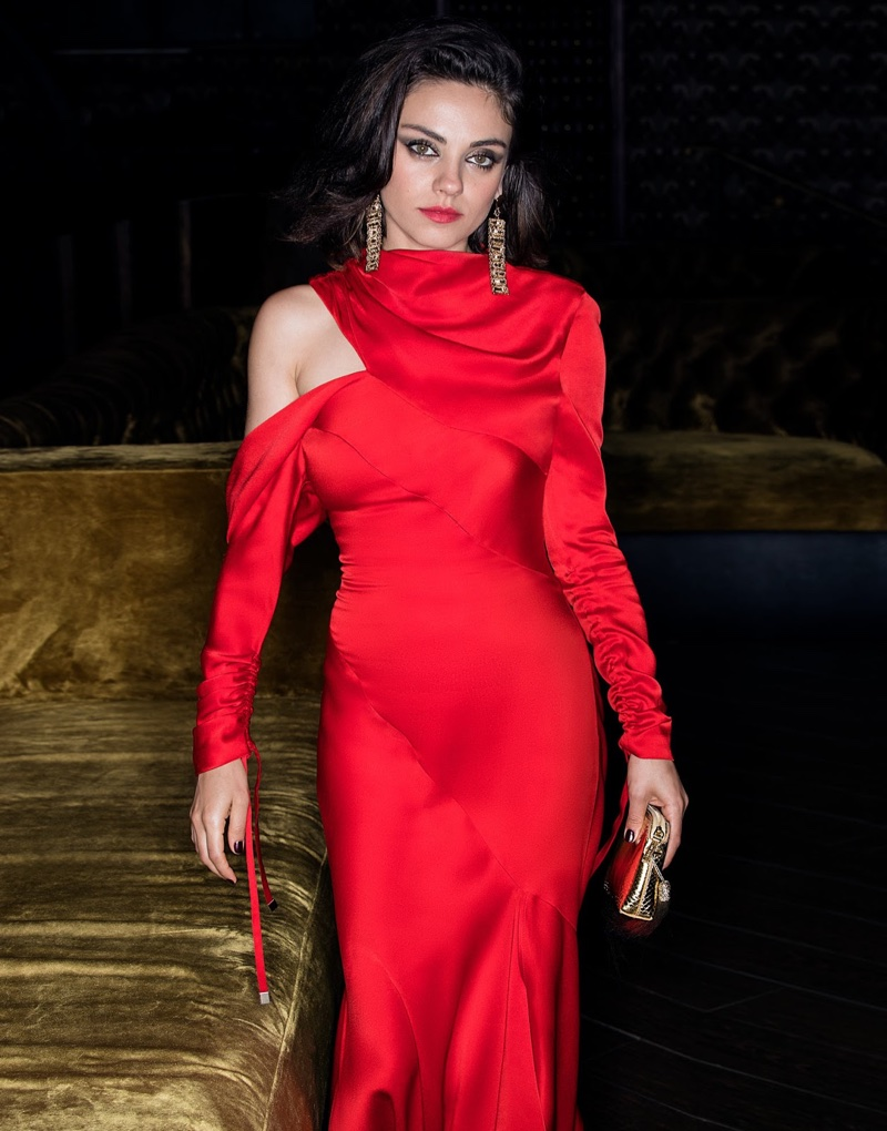 Looking red-hot, Mila Kunis poses in Monse dress, Eddie Borgo earrings and The Row bag