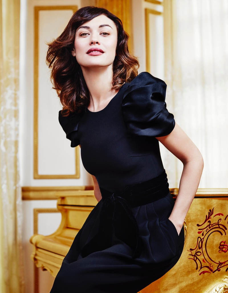 Actress Olga Kurylenko poses in Giorgio Armani dress and belt
