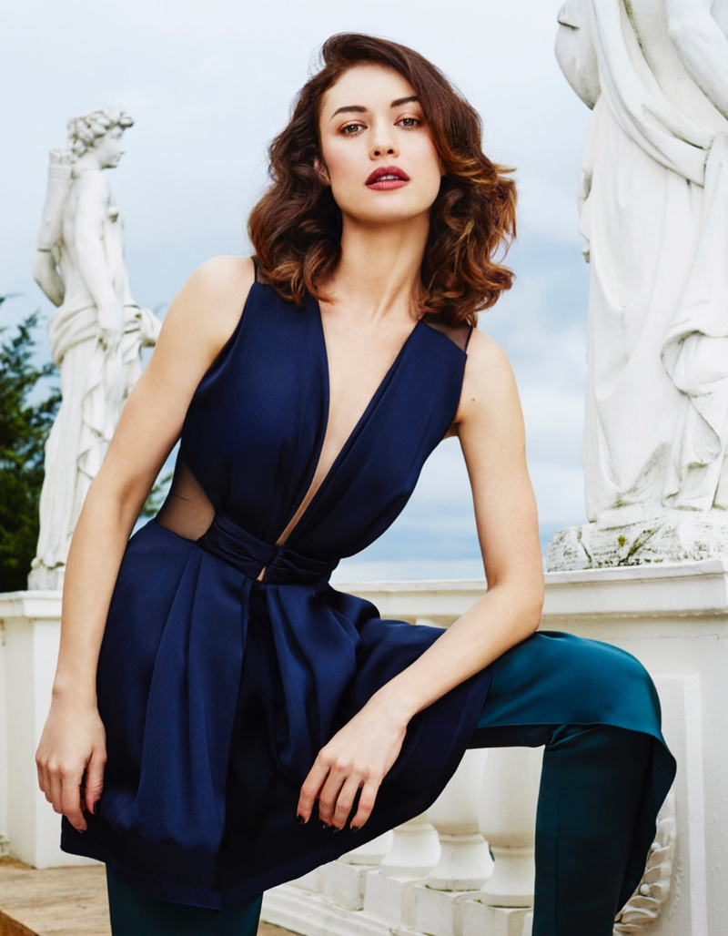 Striking a pose, Olga Kurylenko wears Giorgio Armani dress and pants