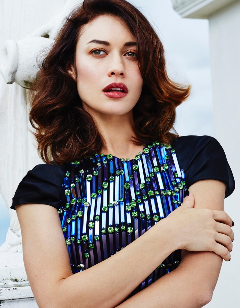 Turning up the shine factor, Olga Kurylenko wears Giorgio Armani embellished top