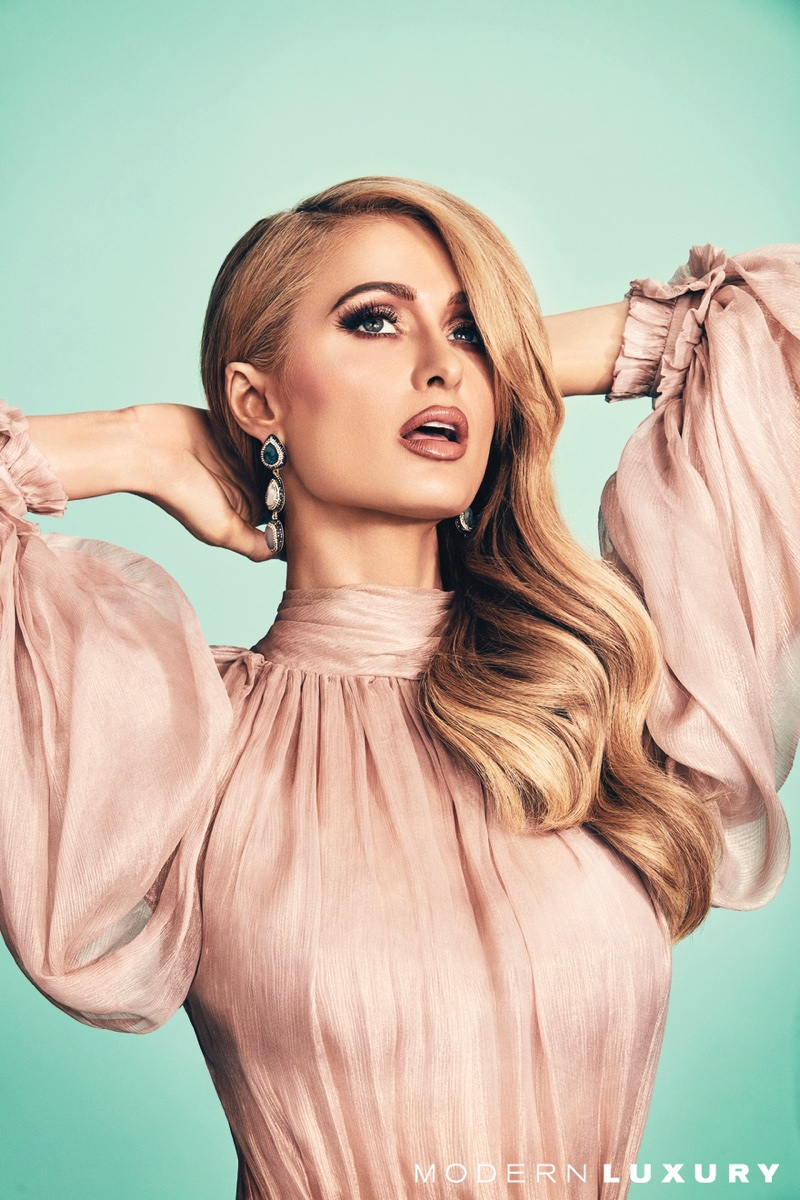 Wearing pink, Paris Hilton poses in Maria Lucia Hohan dress and Native Gem earrings