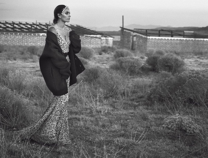 Photographed in black and white, Paris Jackson poses in knit sweater and embroidered gown