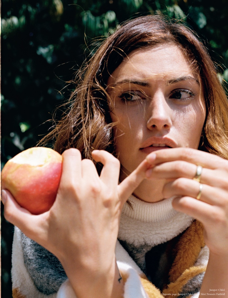 Posing with an apple, Phoebe Tonkin wears Chloe sweater