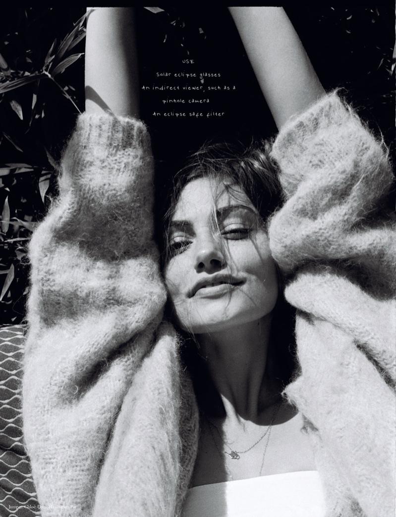Phoebe Tonkin poses in Chloe sweater and Realisation Par dress