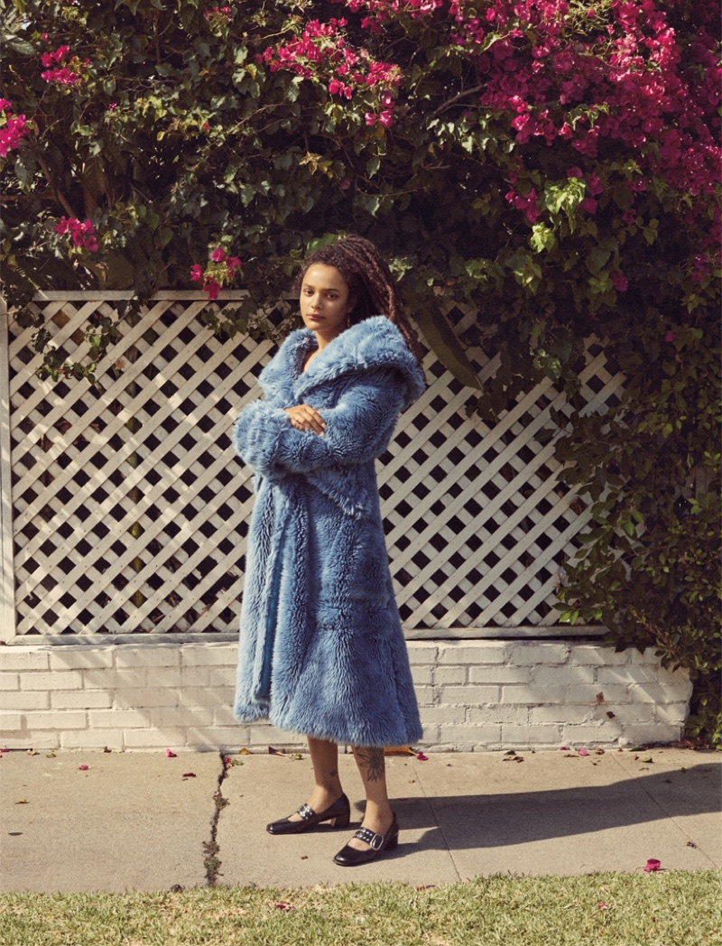 Sasha Lane poses in Miu Miu faux fur coat