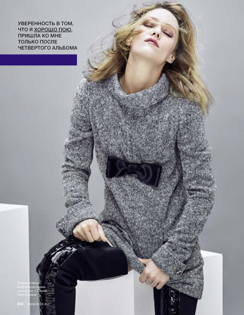 Actress Vanessa Paradis wears grey dress and over-the-knee boots from Chanel Haute Couture