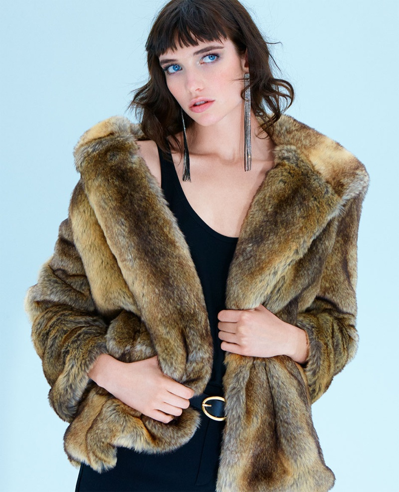 Zara faux fur coat with hood, strappy top, tuxedo trousers and rhinestone fringe earrings