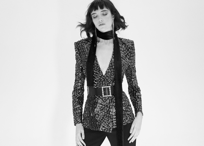 Grace Hartzel wears Zara blazer with sequins, tuxedo trousers, rhinestone fringe earrings and fringe velvet scarf