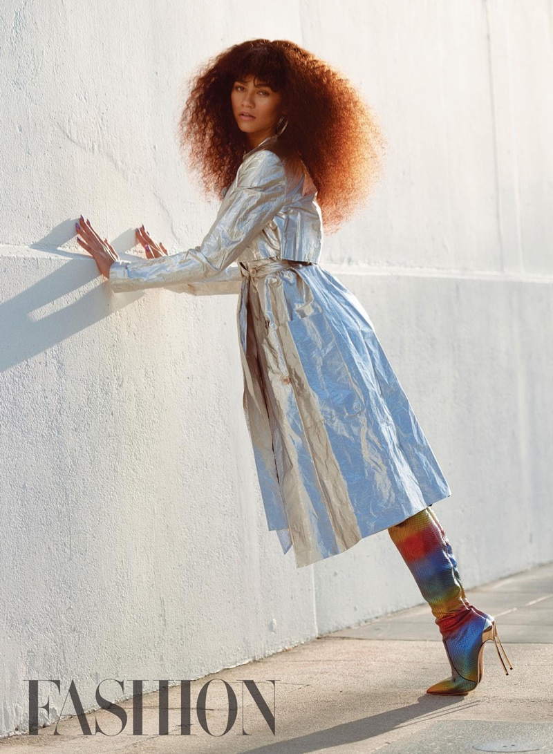Wearing a Sally LaPointe coat, Zendaya poses outdoors in Casadei rainbow boots and Jennifer Fisher earrings