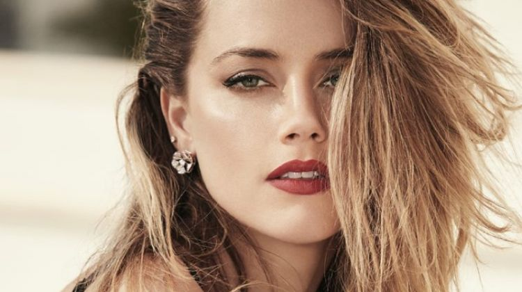 Showing off a tousled hairstyle, Amber Heard poses in lingerie