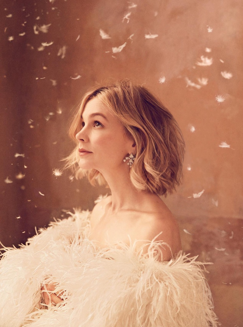 Carey Mulligan poses in Saint Laurent leather and ostrich feather dress