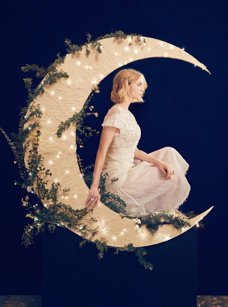 Posing in a crescent moon, Carey Mulligan wears Chanel dress and jewelry