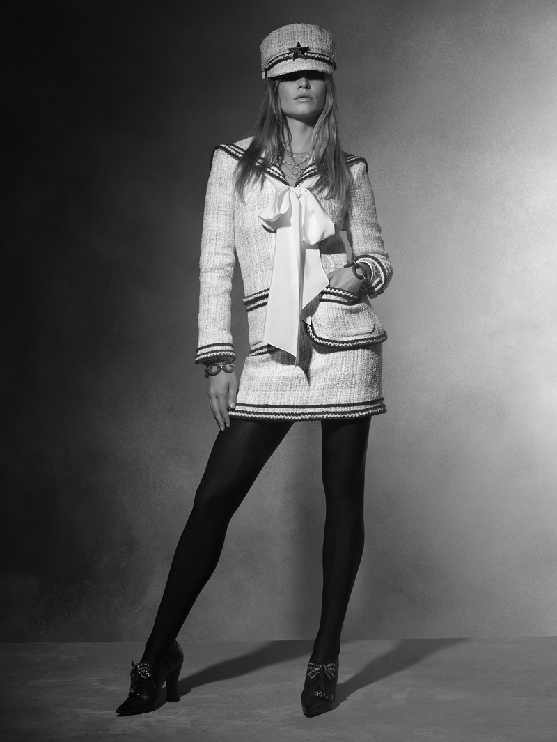 Anna Ewers wears Chanel tweed skirt suit from Chanel's pre-fall 2018 collection
