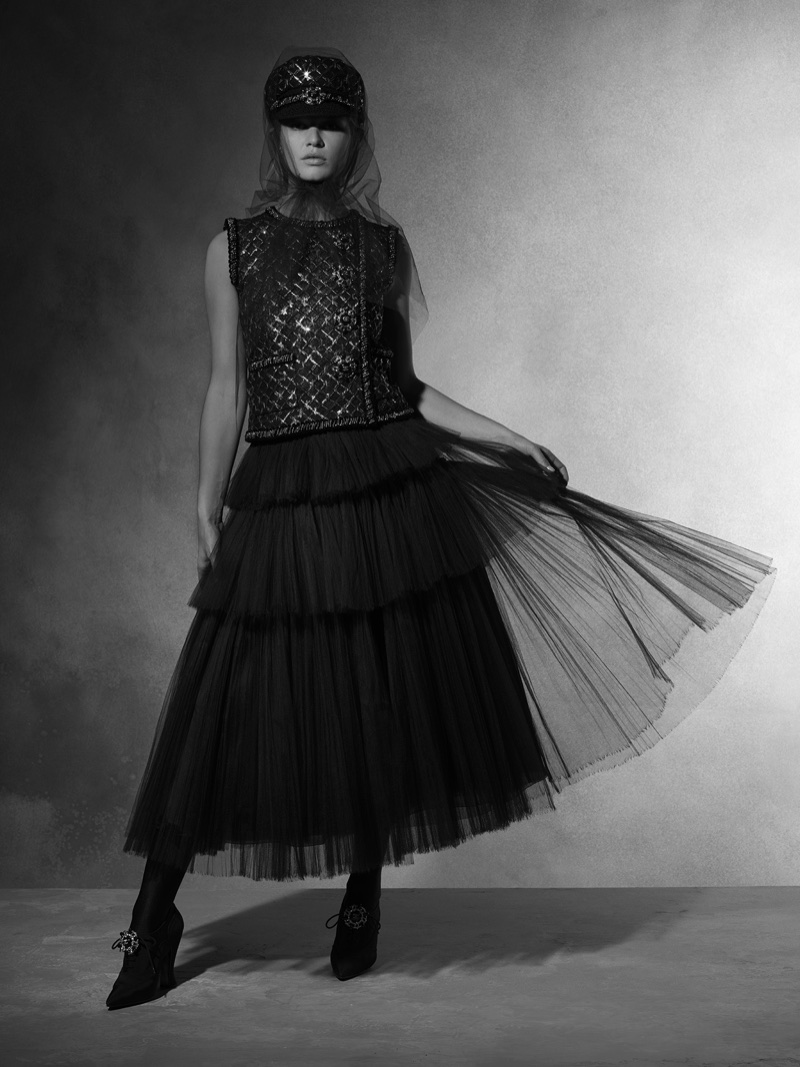 Model Anna Ewers wears embroidered top with tiered skirt from Chanel's pre-fall 2018 collection