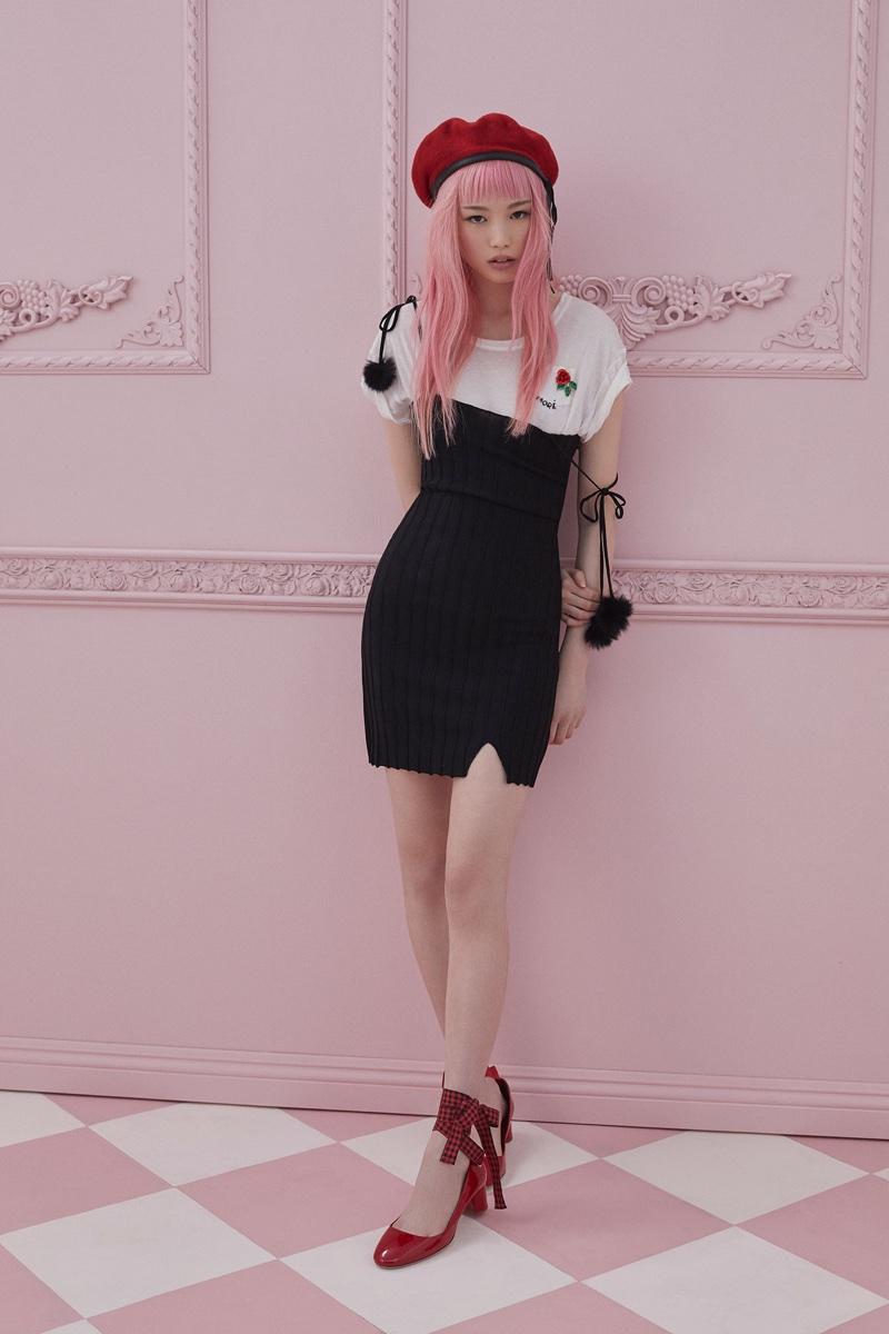 Fernanda Ly poses in little black dress with a t-shirt from For Love & Lemons Knitz