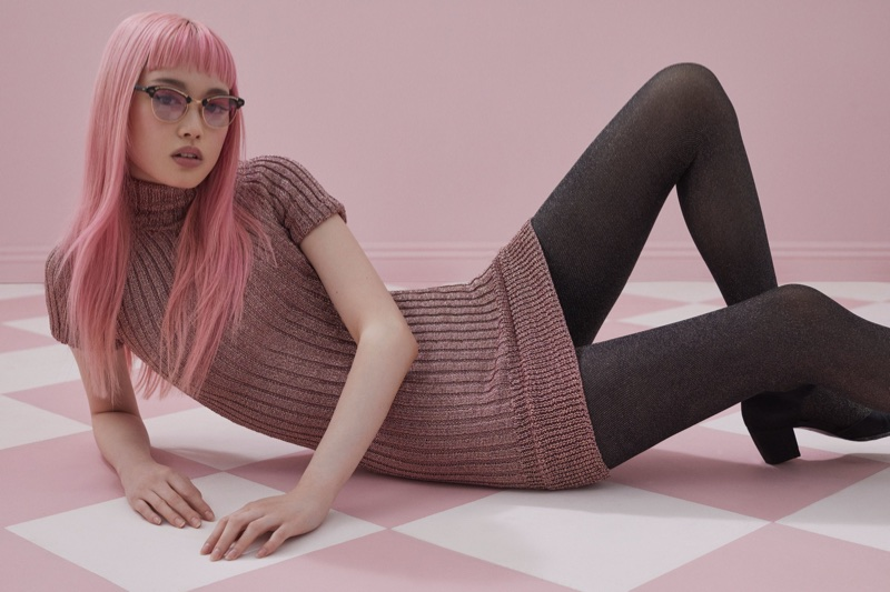 Fernanda Ly poses in For Love & Lemons Knitz turtleneck minidress