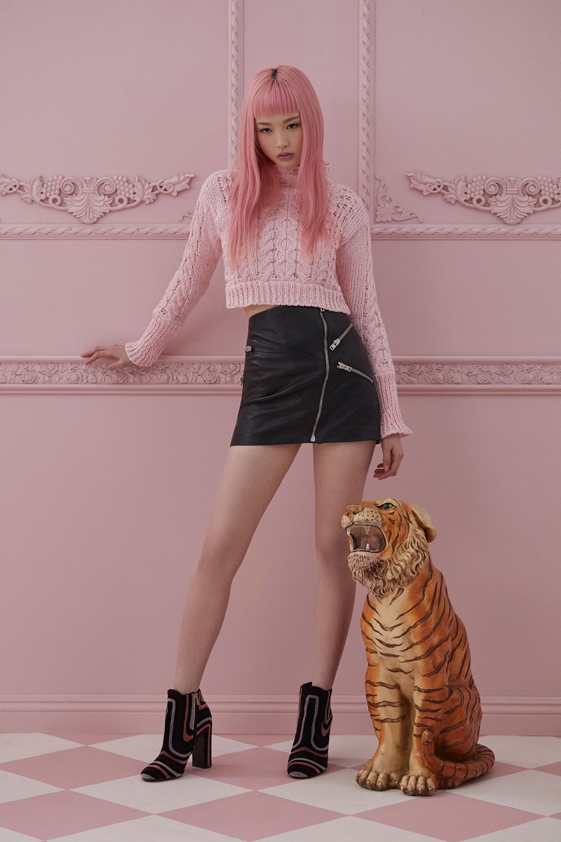 Looking pretty in pink, Fernanda Ly wears cropped pink sweater from For Love & Lemons Knitz