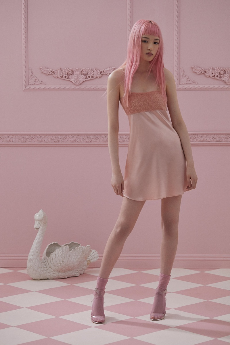 Fernanda Ly poses in pink mini dress from For Love & Lemons Knitz