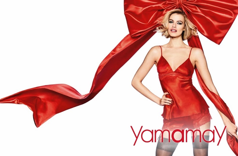 Model Hailey Clauson poses in red camisole for Yamamay's Christmas 2017 campaign