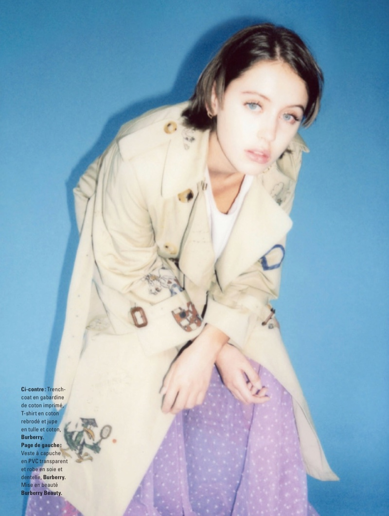 Iris Law poses in Burberry trench coat, t-shirt and skirt