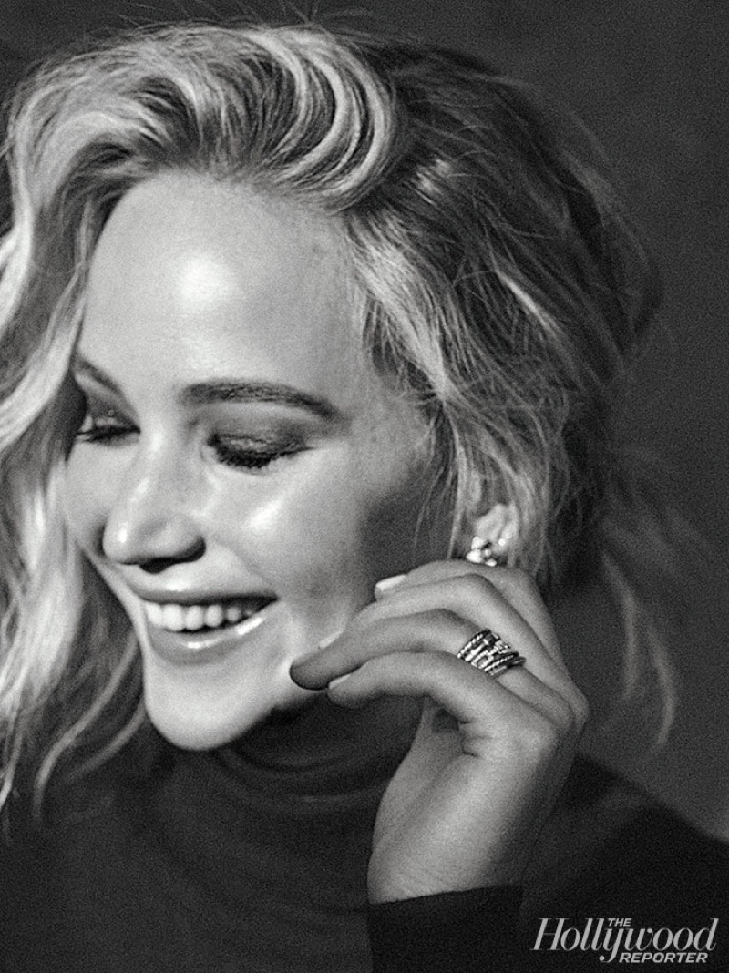 Flashing a smile, Jennifer Lawrence appears in this black and white image