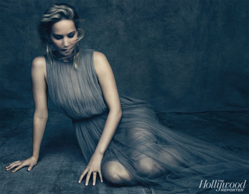 Actress Jennifer Lawrence poses in airy dress