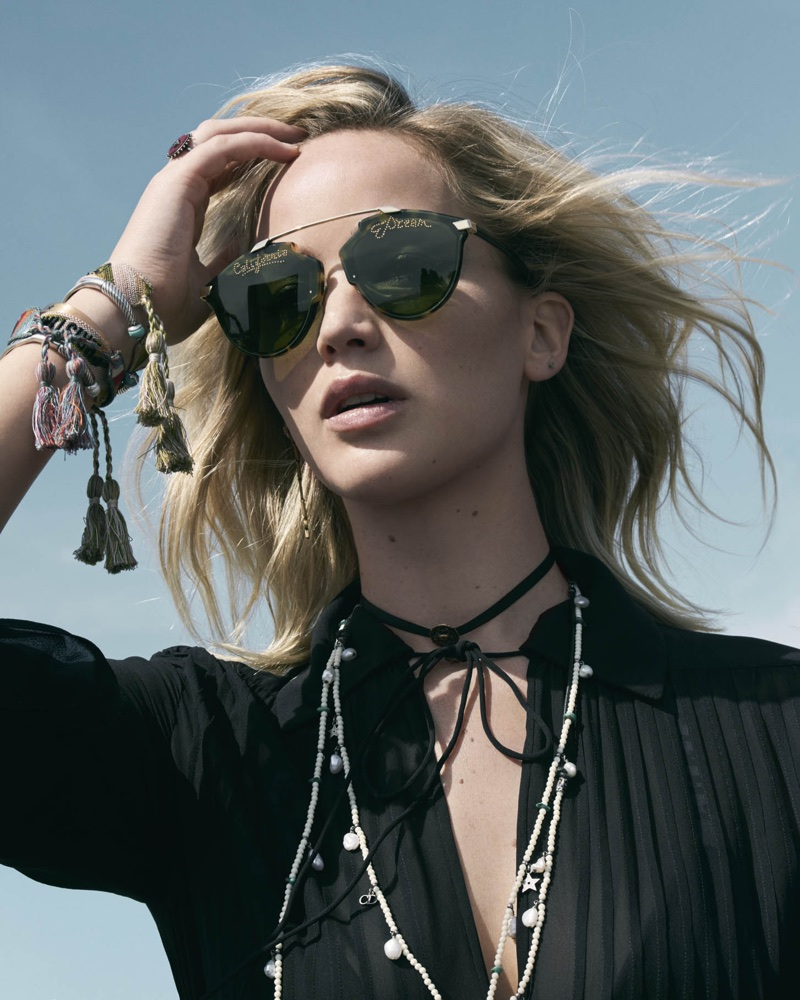 Ready for her closeup, Jennifer Lawrence wears Dior sunglasses and jewelry