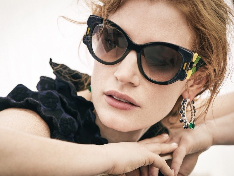 Jessica Chastain wears Azzedine Alaia dress with Prada sunglasses and Piaget jewelry