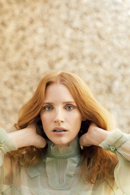 Jessica Chastain poses in high-neck Prada top