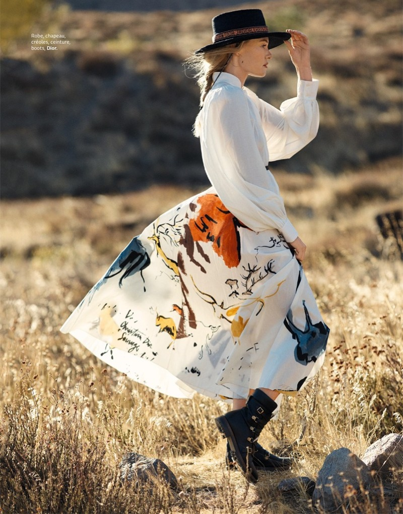 Posing outdoors, Kate Bosworth wears Dior hat, blouse, skirt and boots
