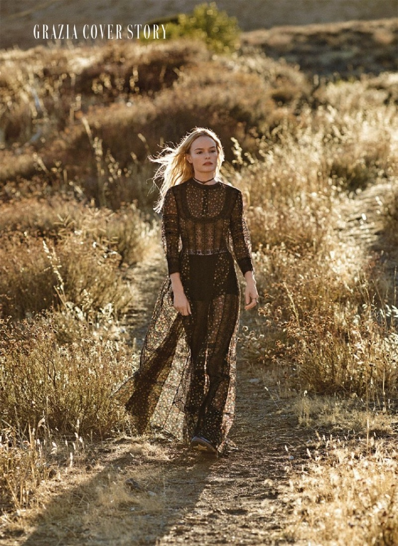 Actress Kate Bosworth poses in Dior dress, briefs and boots