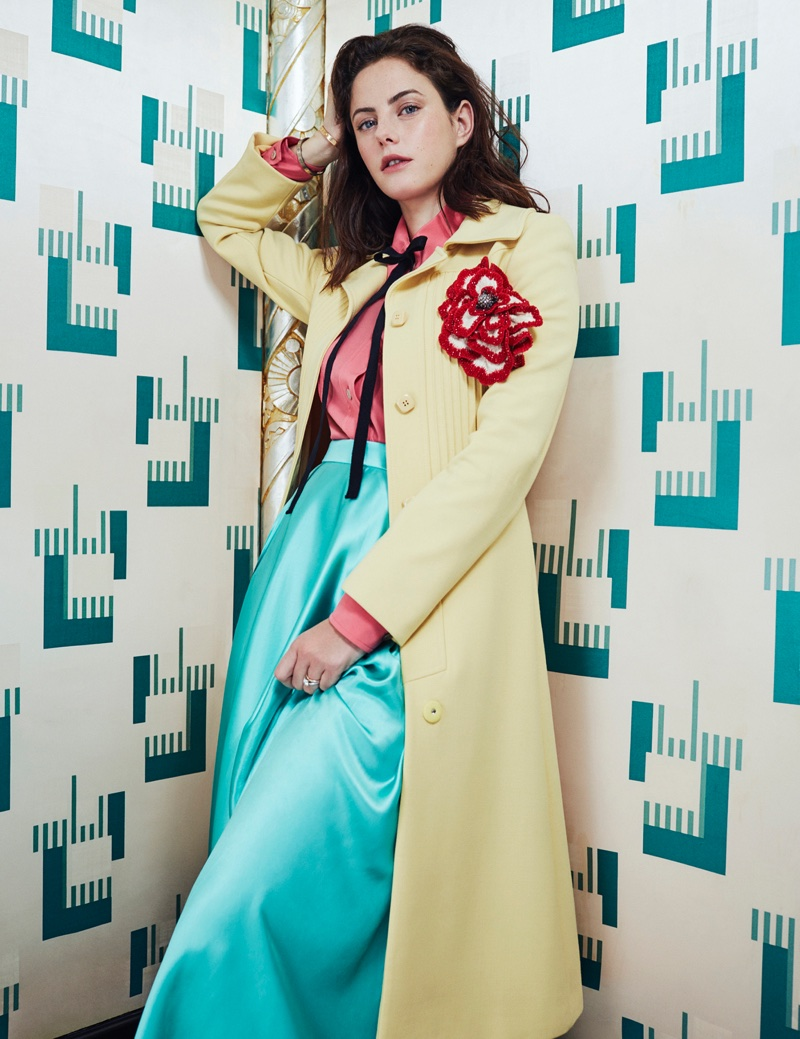 Striking a pose, Kaya Scodelario wears Gucci coat, blouse and skirt