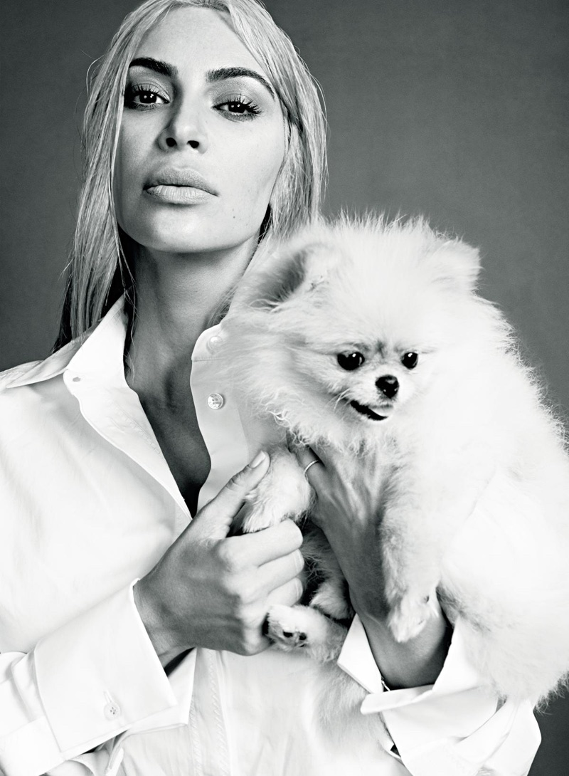 Photographed in black and white, Kim Kardashian wears Tod's men's shirt