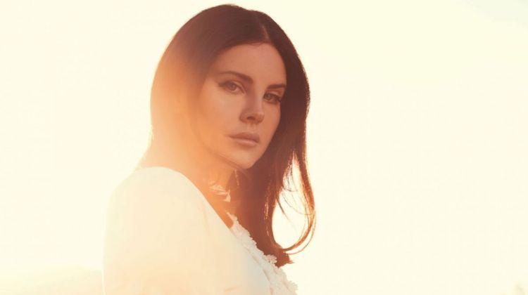 Looking bohemian glam, Lana Del Rey wears white dress