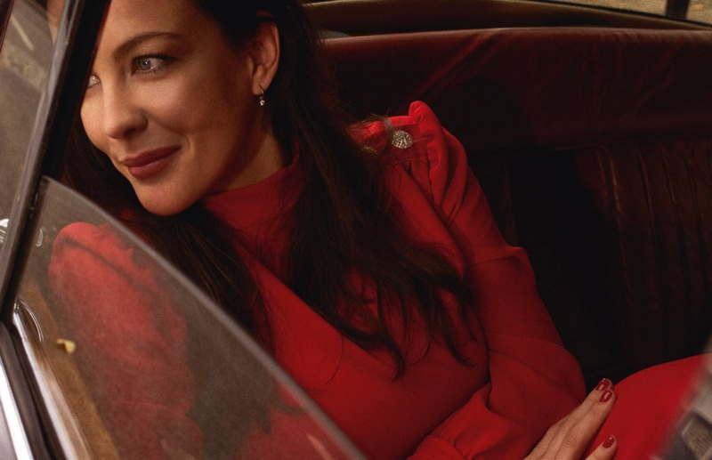 Liv Tyler flashes a smile in a red dress