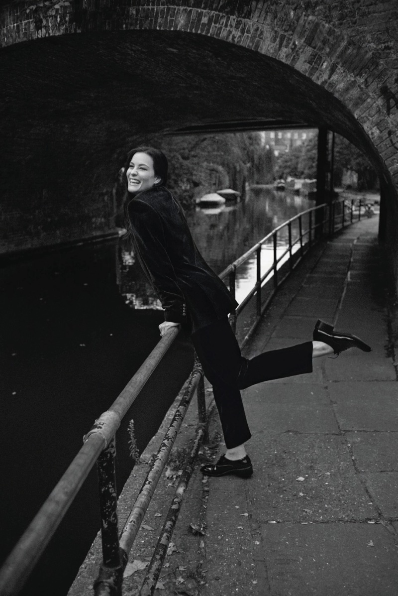 Embracing a simple look, Liv Tyler wears jacket, pants and oxfords