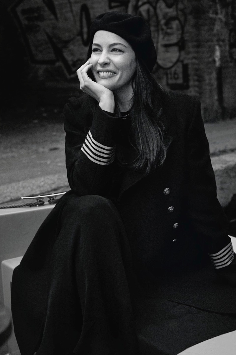 Liv Tyler poses in military inspired jacket for this black and white shot
