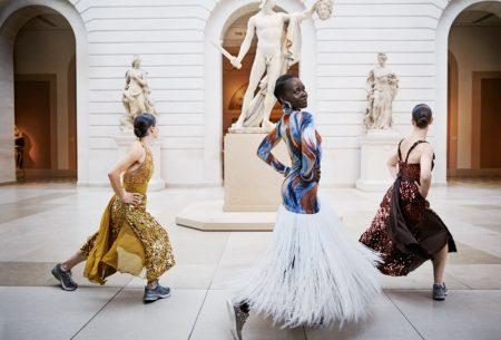 Dancing, Lupita Nyong'o poses in Celine dress, Atelier Swarovski by Christopher Kane bracelets and Giuseppe Zanotti sneakers