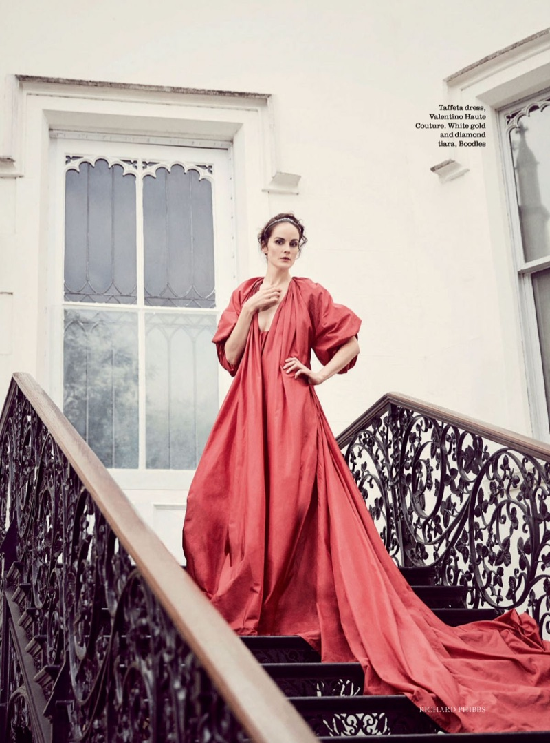 Posing on stairs, Michelle Dockery wears Valentino Haute Couture gown