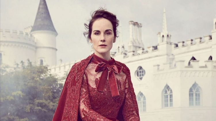 On a horse, Michelle Dockery poses in Elie Saab Haute Couture embroidered dress and cape